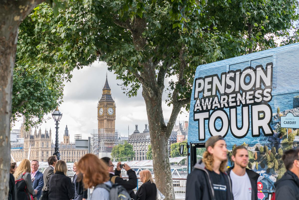 The Pension Awareness bus outside Westminster, with crowds gathered round it.